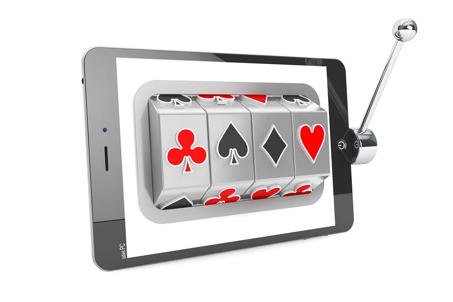 bigstock Slot Machine Inside Tablet Pc 62334125 Internetcasinot